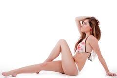 Donna che si siede in bikini Immagine Stock Libera da Diritti