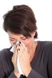 Donna che soffre da un freddo o da un'influenza Fotografia Stock