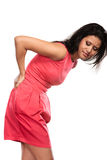 Donna che soffre dal dolore alla schiena di mal di schiena Immagini Stock