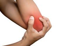 Donna che soffre dal reumatismo unito cronico Dolore del gomito fotografia stock libera da diritti