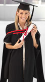 Donna che sorride alla sua graduazione Fotografia Stock