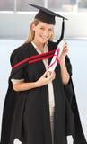 Donna che sorride alla sua graduazione Immagine Stock Libera da Diritti