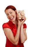 Donna che sorride con la banca piggy Fotografia Stock Libera da Diritti