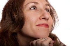 Donna che sorride meditatamente Immagini Stock Libere da Diritti