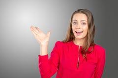 Donna che sta indicante il suo dito Immagine Stock Libera da Diritti