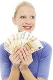 Donna che tiene euro soldi Immagine Stock