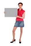 Donna che tiene segno in bianco Fotografia Stock