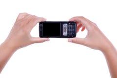 Donna che tiene telefono mobile immagini stock libere da diritti