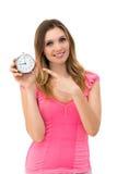 Donna che tiene un orologio Fotografie Stock Libere da Diritti