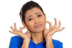 Donna che tira le orecchie commoventi spiacenti per cui ha fatto Immagine Stock Libera da Diritti