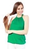 Donna che tocca i suoi capelli fotografia stock
