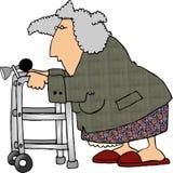 Donna che usando un camminatore Fotografie Stock