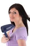 Donna che usando un hairdryer Fotografia Stock Libera da Diritti