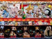 Donna che vende i giocattoli del circo Immagine Stock