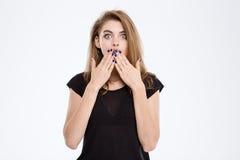 Donna colpita che copre la sua bocca Immagine Stock