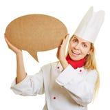 Donna come cuoco del cuoco unico con il fumetto fotografia stock
