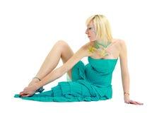 Donna con arte di corpo che si siede su un bianco Immagini Stock Libere da Diritti