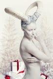 Donna con body art della capra Immagini Stock