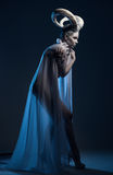 Donna con body art della capra Fotografia Stock