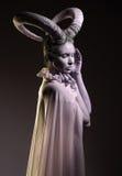Donna con body art della capra Fotografie Stock