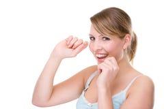 Donna con filo per i denti Immagini Stock Libere da Diritti