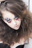 Donna con fronte-arte creativa - fantasia di carnevale fotografia stock libera da diritti
