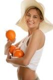 Donna con gli aranci Fotografia Stock Libera da Diritti