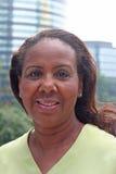 Donna con gli edifici per uffici Immagine Stock Libera da Diritti