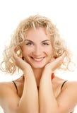 Donna con i capelli dell'arricciatura Immagine Stock