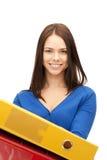 Donna con i dispositivi di piegatura Immagine Stock Libera da Diritti