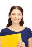 Donna con i dispositivi di piegatura Fotografie Stock