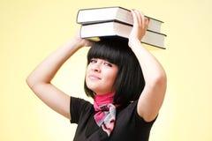 Donna con i grandi libri Fotografia Stock