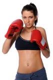 Donna con i guanti di inscatolamento Fotografia Stock Libera da Diritti