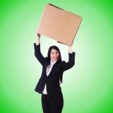 Donna con i lotti delle scatole su bianco Immagine Stock Libera da Diritti