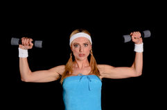 Donna con i pesi fotografia stock libera da diritti