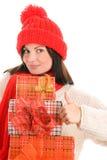 Donna con i regali che danno i pollici in su Fotografia Stock