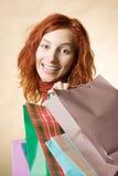 Donna con i sacchetti fotografie stock