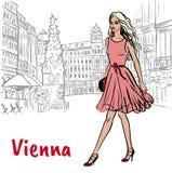 Donna con i sacchetti della spesa a Vienna Immagini Stock