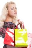 Donna con i sacchetti di acquisto Immagini Stock