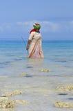 Donna con i vestiti variopinti Immagini Stock Libere da Diritti