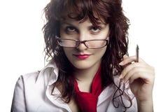 Donna con i vetri e la penna Fotografia Stock Libera da Diritti