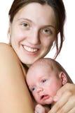 Donna con il bambino appena nato Immagine Stock