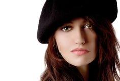 Donna con il berreto Fotografie Stock