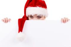 Donna con il bordo vuoto in bianco dell'insegna Natale Fotografia Stock