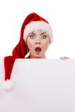 Donna con il bordo vuoto in bianco dell'insegna Natale Immagini Stock
