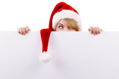 Donna con il bordo vuoto in bianco dell'insegna Natale Fotografia Stock Libera da Diritti
