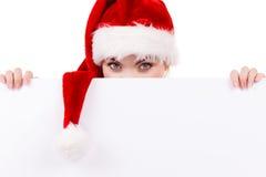Donna con il bordo vuoto in bianco dell'insegna Natale Fotografie Stock Libere da Diritti