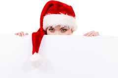 Donna con il bordo vuoto in bianco dell'insegna Natale Immagine Stock