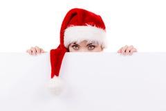 Donna con il bordo vuoto in bianco dell'insegna Natale Fotografie Stock