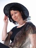 Donna con il cappello nero Fotografia Stock Libera da Diritti